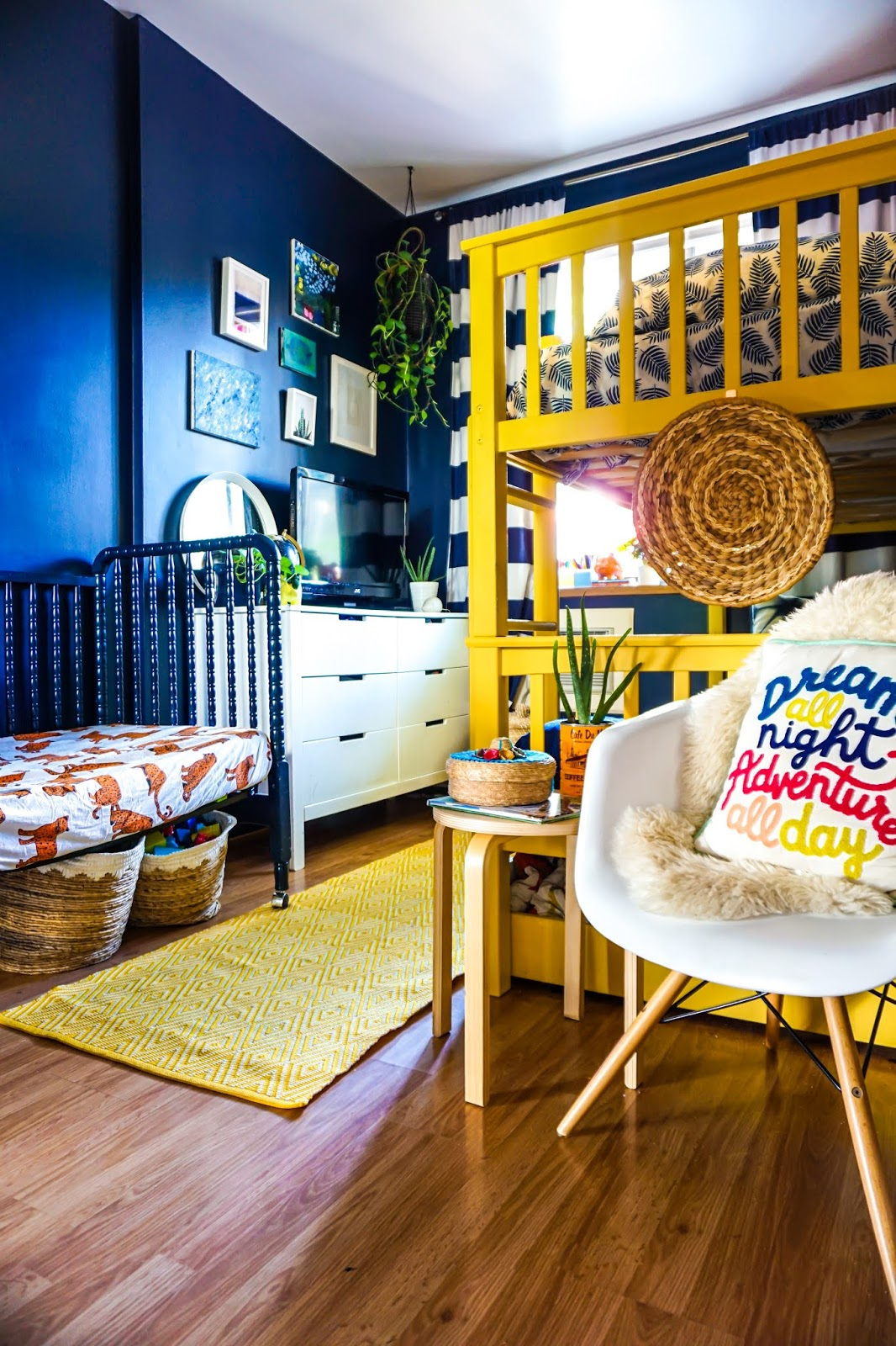 colorful kids bedroom ideas // colorful kids room // colorful boys room // colorful bohemian kids bedroom // Clare paint golden hour // clare paint goodnight moon // best paint for kids bedroom // non-voc paint clare // boho kids room // tropical inspired kids bedroom // tropical inspired boys room // Hawaii inspired boys room // bohemian kids room decor // colorful kids room inspo // yellow bunk bed // navy walls kids bedroom // boho kids decor