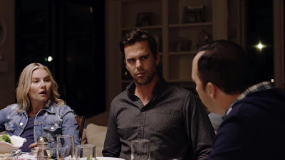 "Elisha Cuthbert and David Walton have dinner with Tony Hale in a movie still for the film ""Eat Wheaties!"""