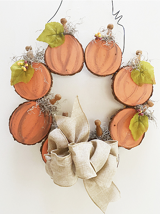 Fall wreath with pumpkins and a bow
