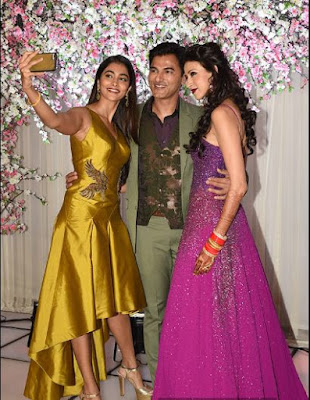 a-guest-taking-selfie-with-alesia-raut-in-wedding-reception