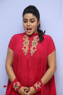 Actress Poorna Latest Stills in Red Dress at Rakshasi First Look Launch  0058.JPG