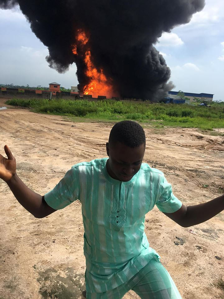 Guy poses with burning petrol tanker after 4 people died in explosion