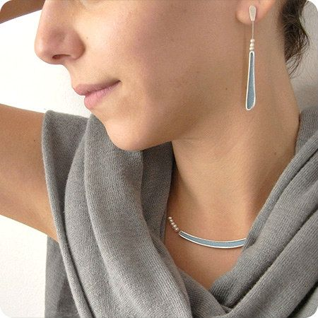 model wearing silver and pale blue paper earrings and necklace