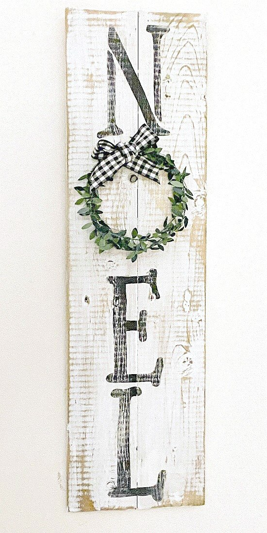 Rustic distressed NOEL sign with wreath for the O