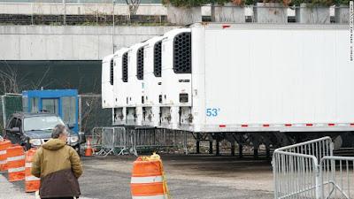 Refrigerator trucks serving as hospital morgue in New York City.