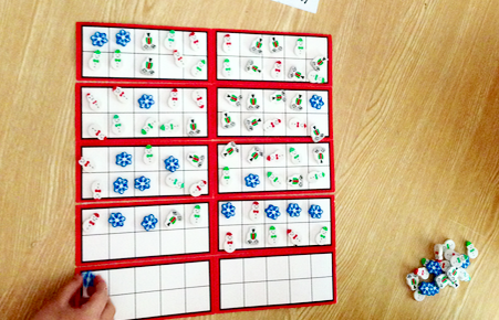 roll the dice and put that number of erasers on hundreds chart