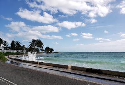 Rough sea splashing against roadside wall
