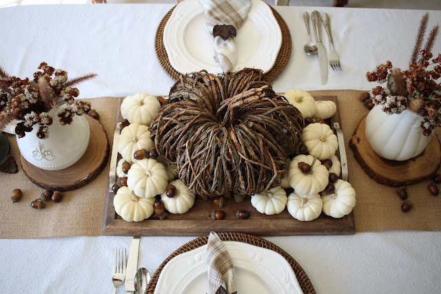natural fall tablescape in browns and creams with pumpkins and wild flowers