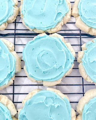 sugar cookies with aqua almond frosting on top