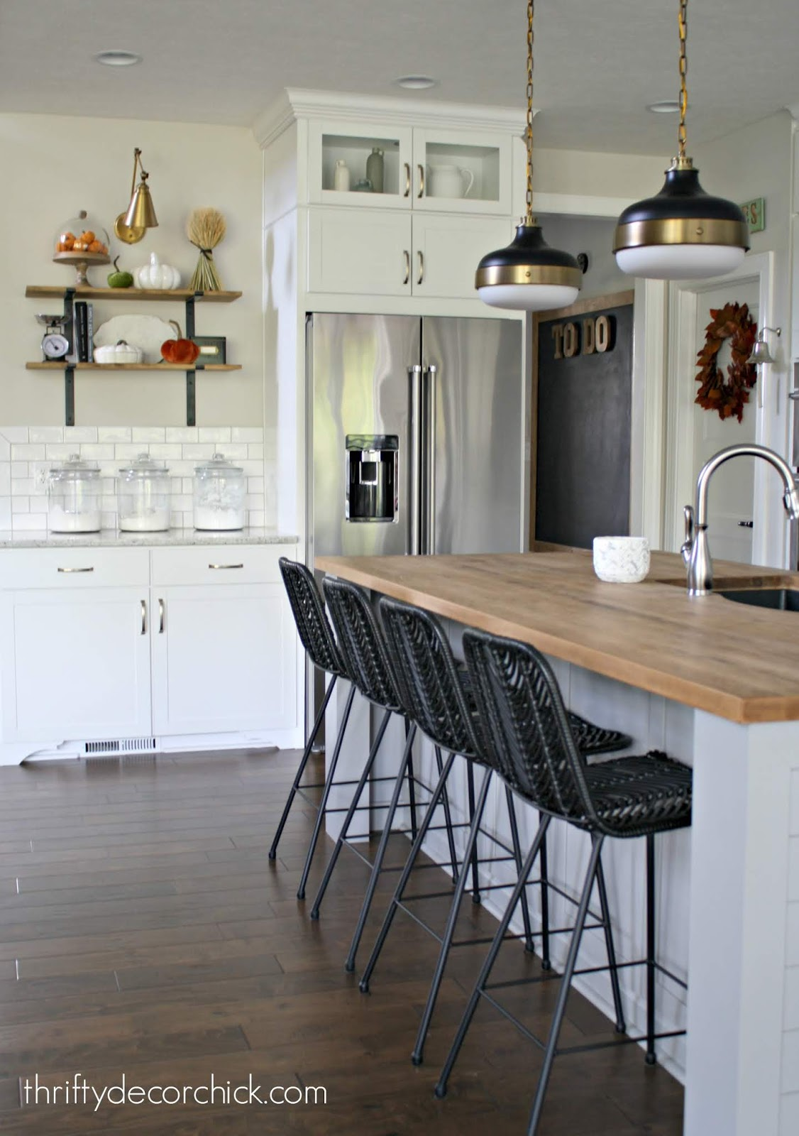 Black stools light gray island white kitchen