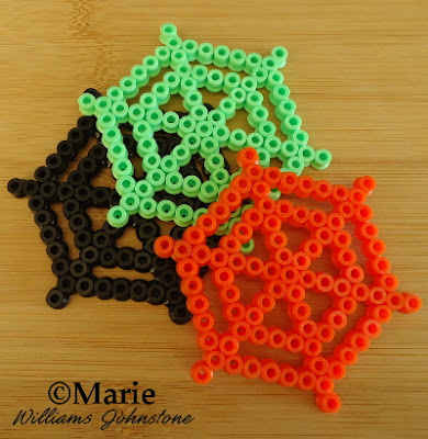 webs spider cobwebs bead design black green orange