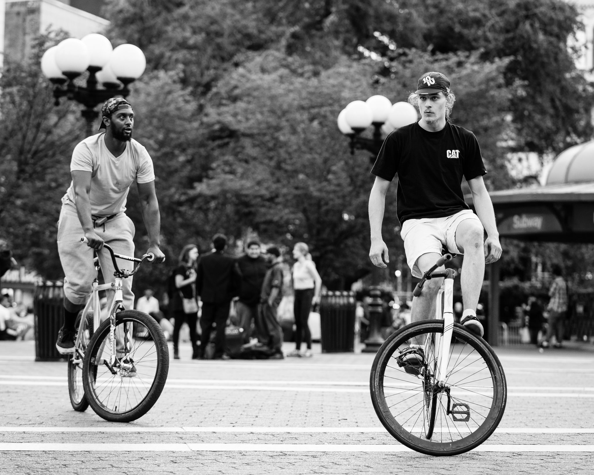 a photo of men doing stunts on bikes in union square park new york city