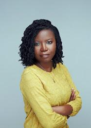 IMAGE: Black Woman in Yellow Sweater