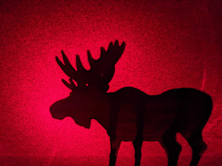 Moose Silhouette Against Red Sky