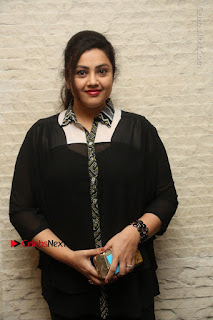 Tamil Actress Meena Latest Stills in Black Dress at TSR TV9 Awards Press Meet  0015.JPG