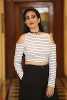Manjusha in sleevelss crop top and black skirt at Darshakudu pre release ~  Exclusive Celebrities Galleries 081.JPG