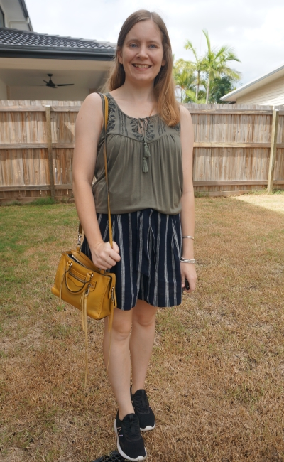 olive embroidered tank with navy stripe culotte shorts, mustard rebecca minkoff micro regan and new balance sneakers | away from blue