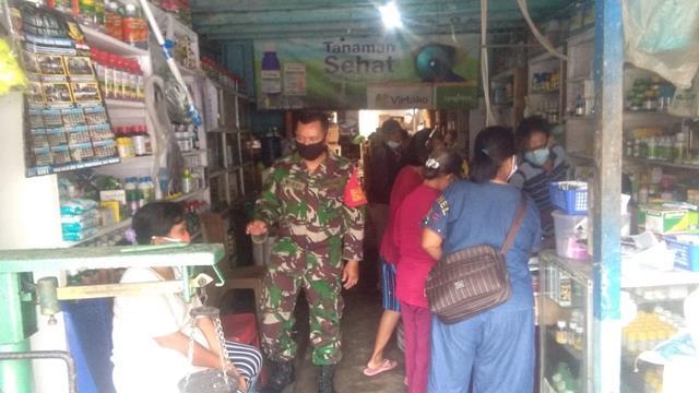 Stop Penyebaran Covid-19, Personel Jajaran Kodim 0207/Simalungun Laksanakan Ops PPKM Micro Patuh Toba 21