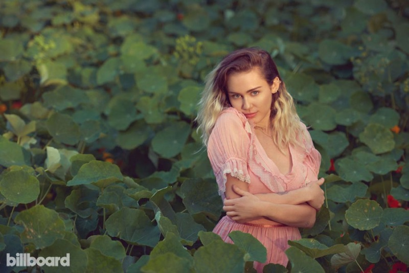 Singer Miley Cyrus looks pretty in pink for Billboard Magazine