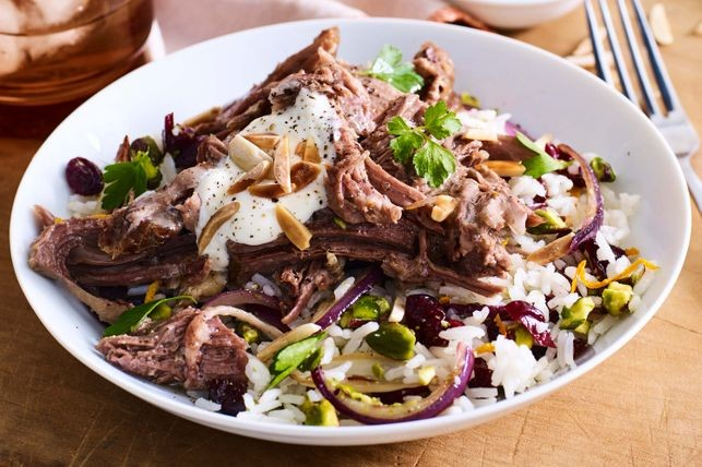 try this tender roast lamb served with a zesty pistachio and cranberry rice Persian lamb with citrus jewelled rice recipe