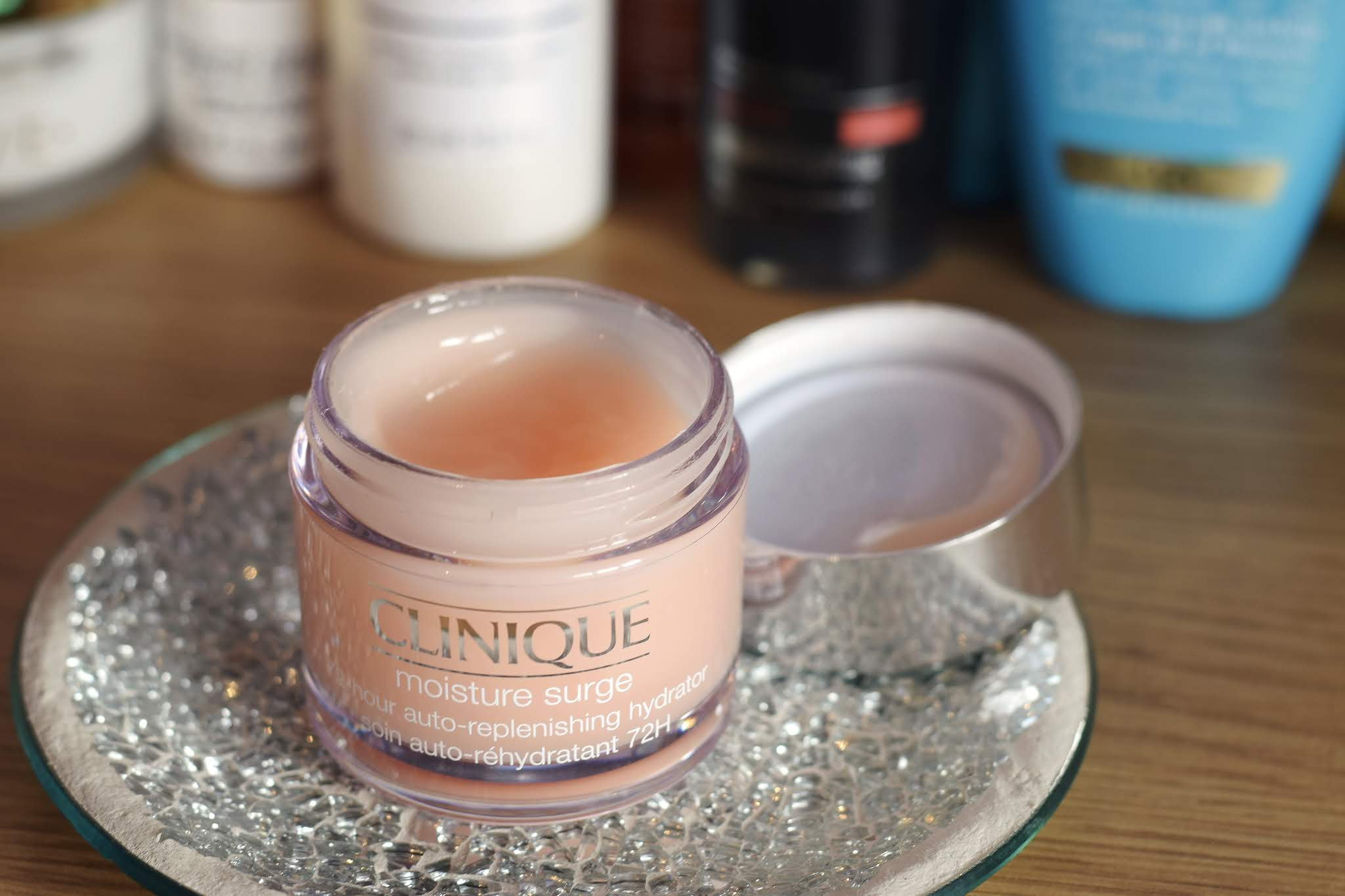 A pot of Clinique Moisture Surge with the lid off so the moisturiser can be seen