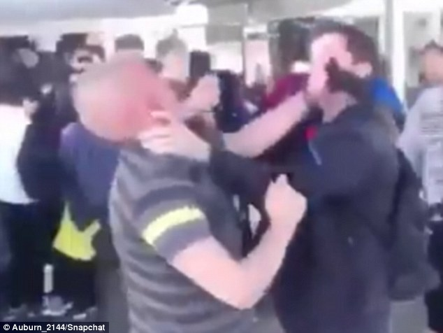 Two men filmed while fighting at Sydney train station and almost falling onto the tracks