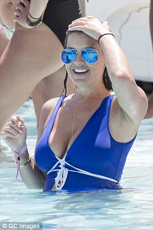 Imogen Thomas in vibrant blue swimsuit and matching sunnies as she relaxes on Ibiza