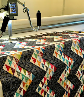half square triangles set in a zigzag for a quilt