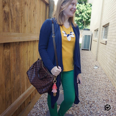awayfromtheblue Instagram | green jeans and mustard yellow tee outfit autumn with navy waterfall cardigan louis vuitton speedy bandouliere