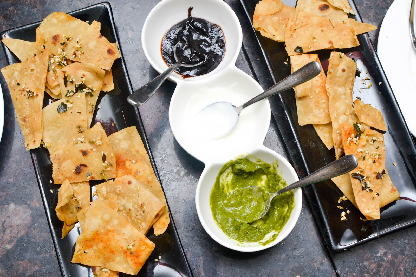 Indian crisps with mint sauce, yoghurt and tamarind sauce