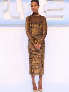 Zoe Saldana in a Burberry long sleeve and high neck black and gold mayan print velvet dress