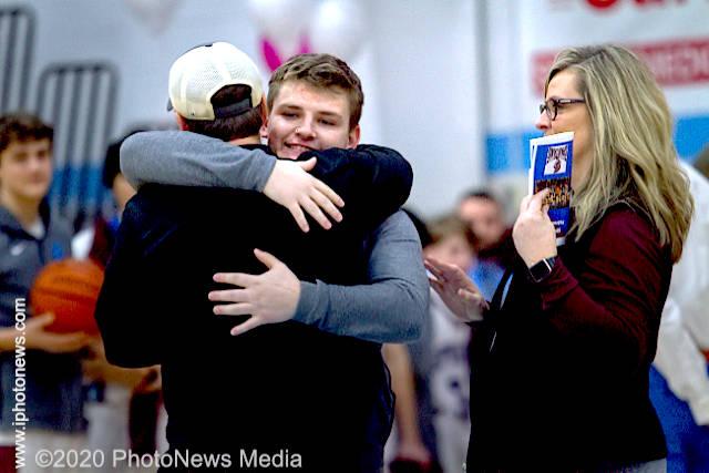 Brayden Weaver hugs his dad on senior night