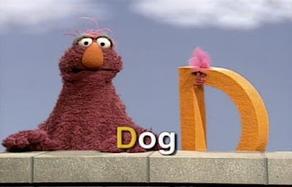 A muppet D and Telly presents the letter D and D words. Sesame Street All Star Alphabet