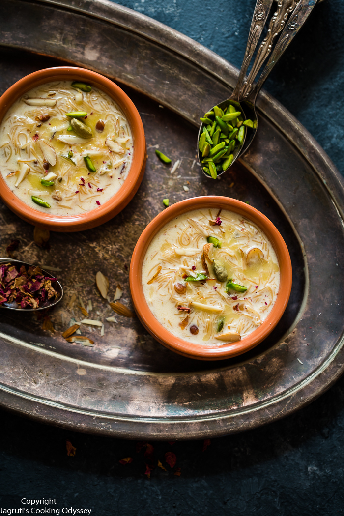 A perfect dessert for Eid celebrations, served in a bowl on a rustic metal tray.