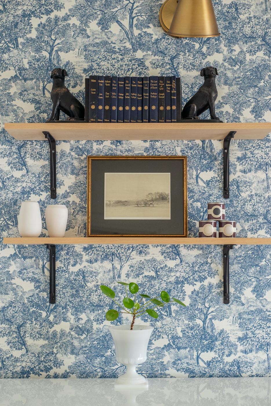 floating shelves in office, toile wallpaper, blue floral wallpaper
