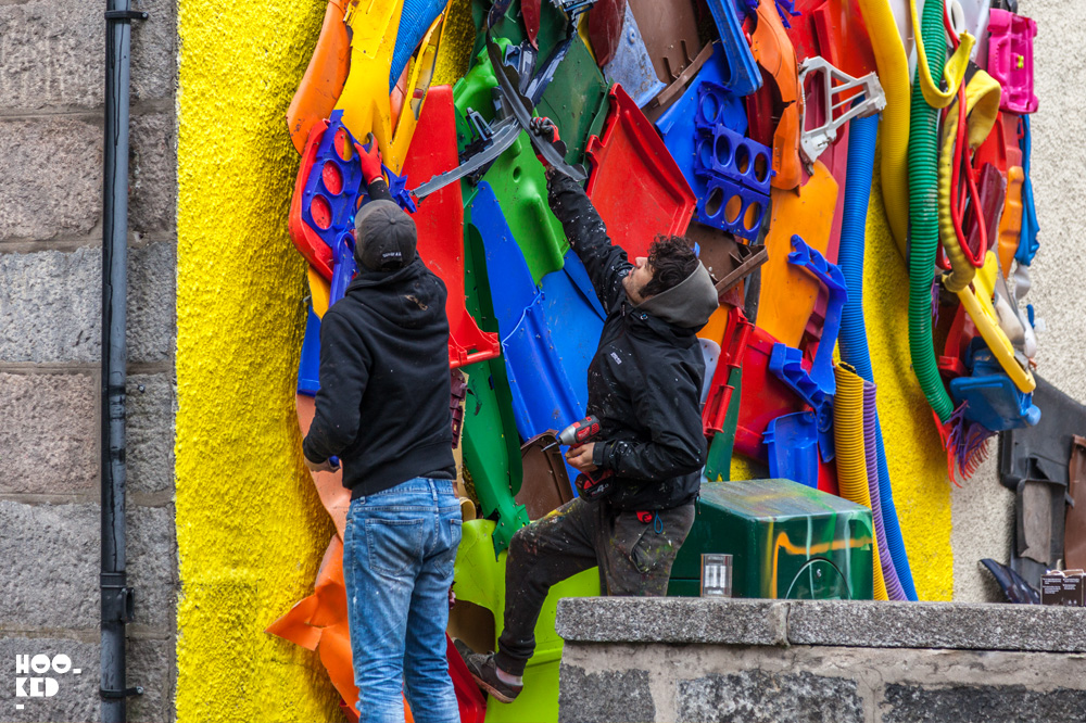 Portuguese graffiti artist Bordalo II at work on his Scottish Unicorn sculpture
