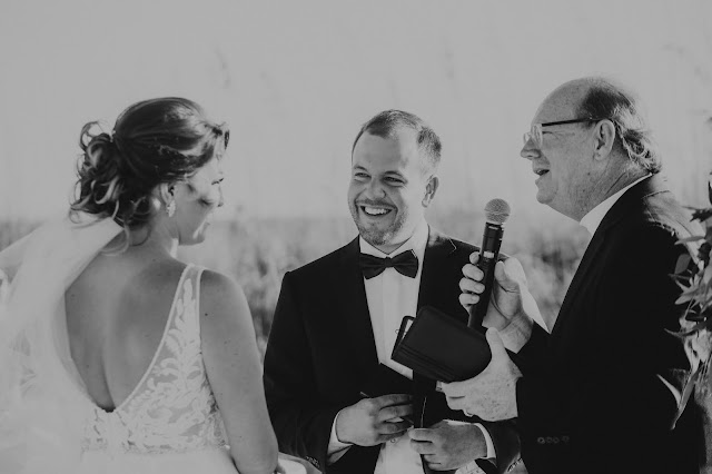 Professional candid photos of bride and groom during ceremony