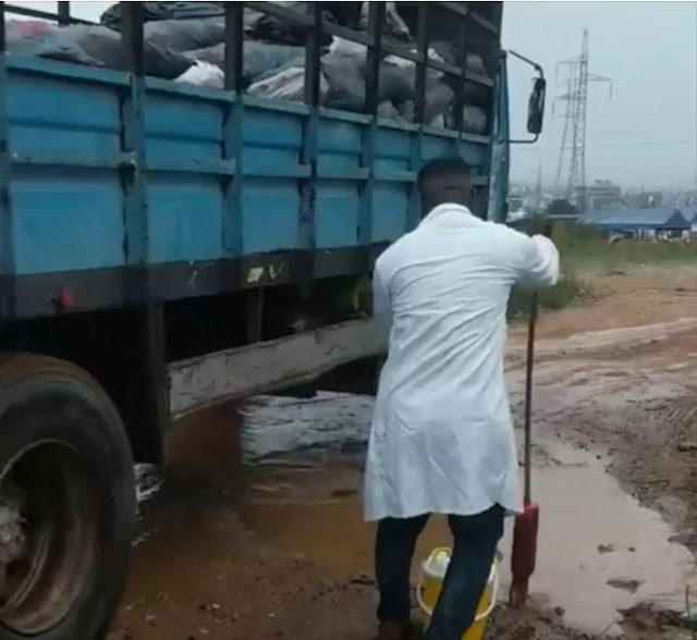 Hilarious Moment A Doctor Was Spotted Mopping The Muddy Ground After A Heavy Rain In Ghana