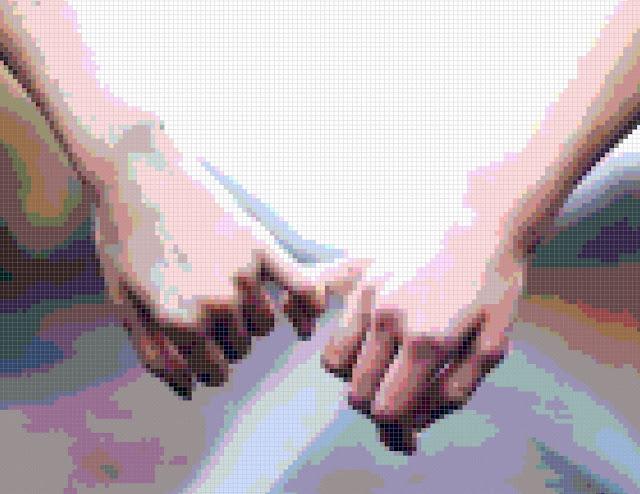 closeup view of pixel-art hands photo