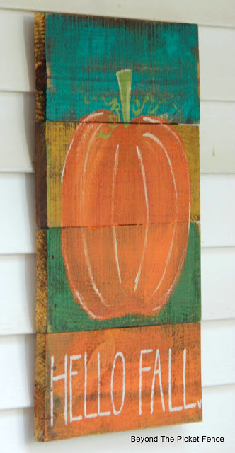a simple sign for fall handpainted on a pallet boards