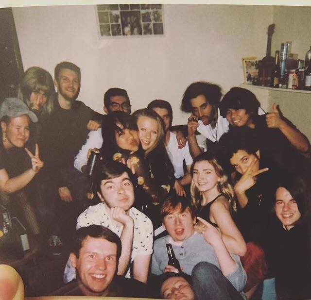 group photo at a house party