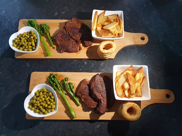 Date night meal at home, steak, home made chips, onion rings, peas & brocolli.