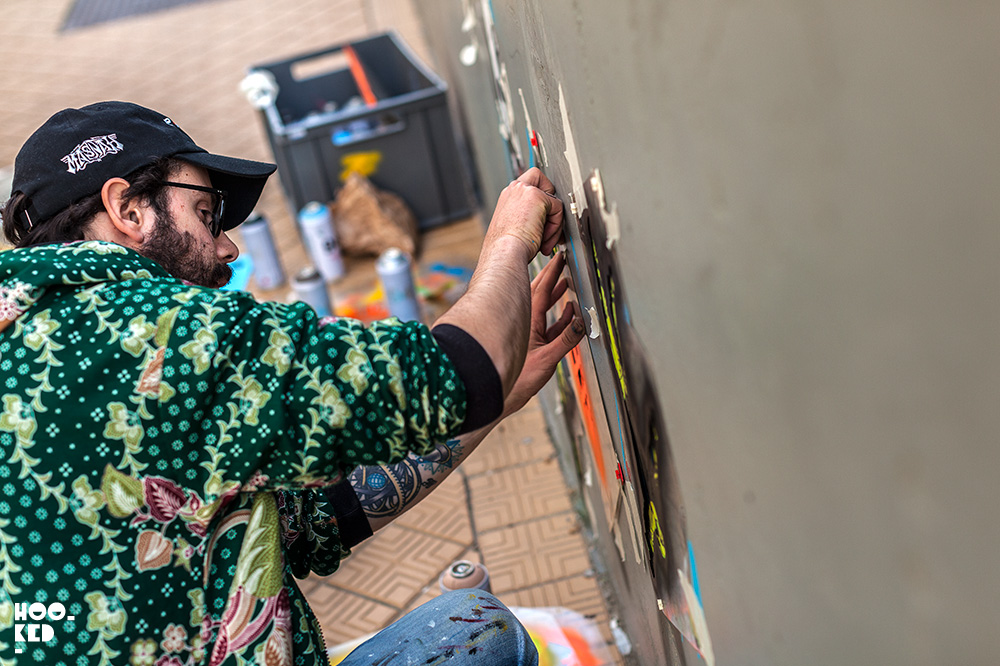 Street Artist Jaune at work on a stencil piece in Ostend, Belgium. Photo ©Hookedblog / Mark Rigney