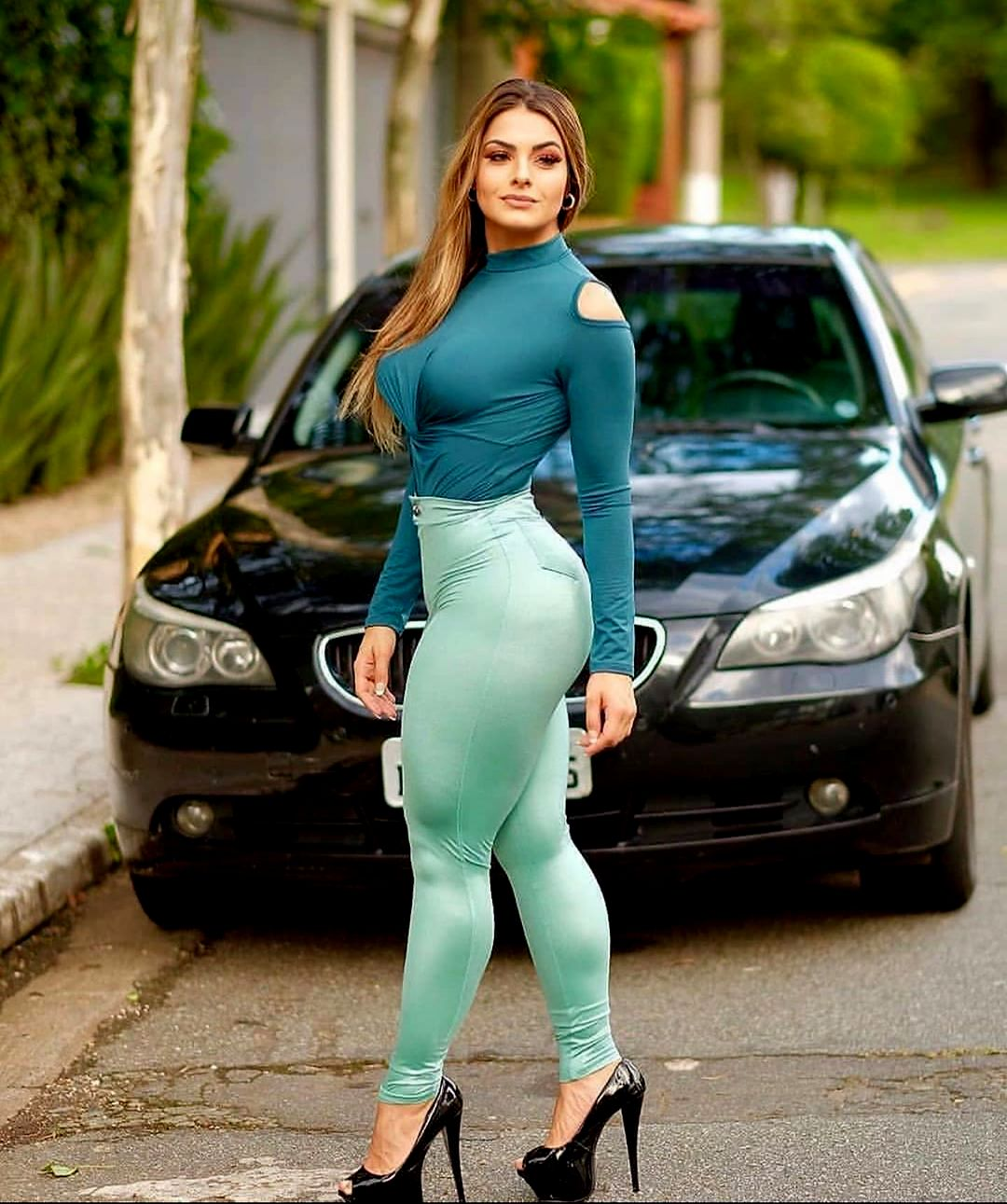Stylish Fitness Give Pose in front of Car