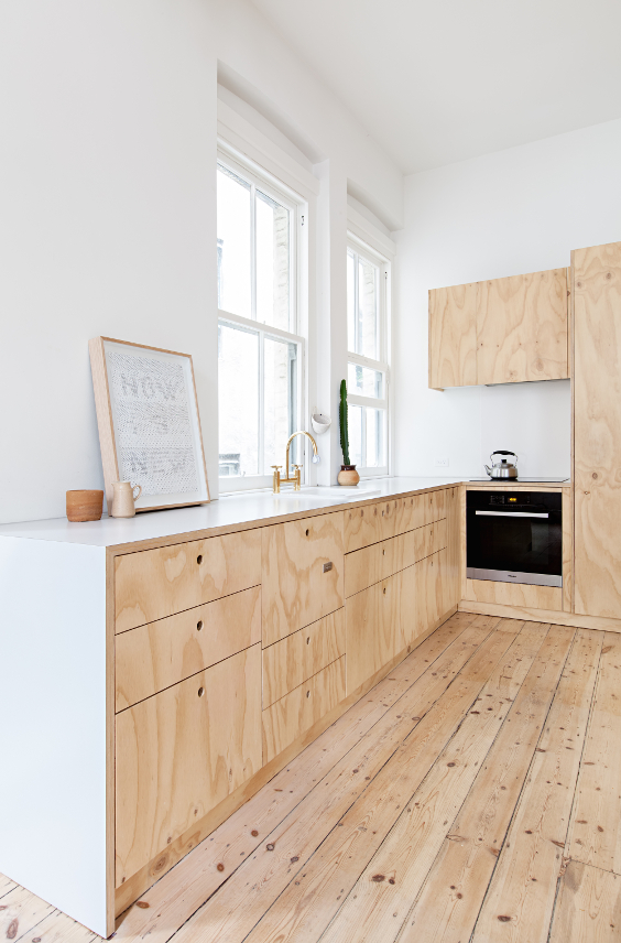 plywood minimal kitchen with no handles