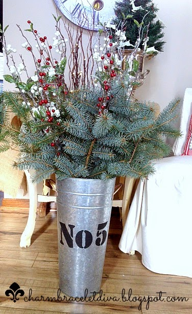 Stencilled galvanized French flower bucket Christmas greens lit branches