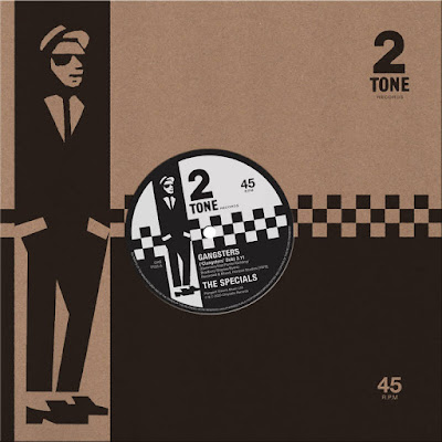 "The 7"" single sleeve and paper label feature checkerboards, a stylized illustration of Peter Tosh as a rude boy, and the 2 Tone Records logo."