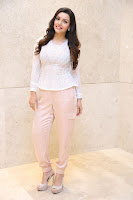 Kyra Dutt in Tight White Top Trousers at Paisa Vasool audio success meet ~  Exclusive Celebrities Galleries 032.JPG