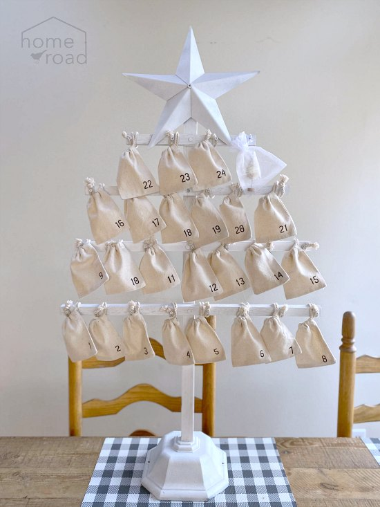 Large wooden advent calendar with muslin numbered bags
