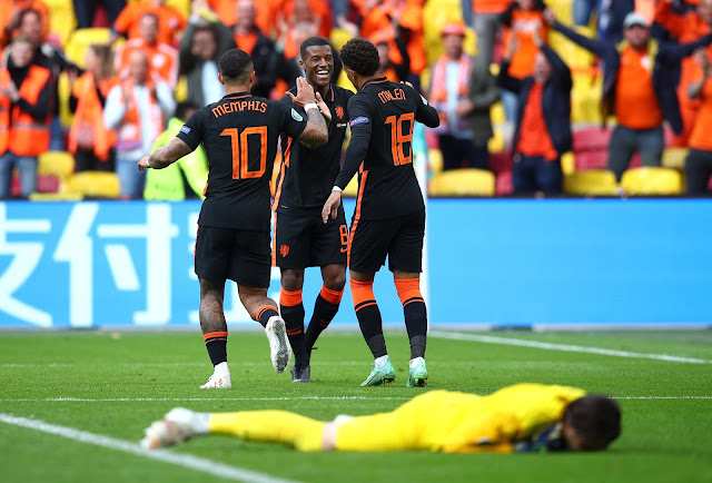 Depay, Wijnaldum, Malen celebrating for Netherlands at Euro 2020